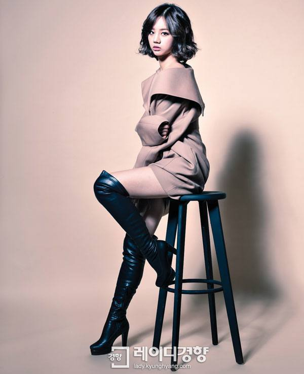 "Photo of ""Mellow Muse,"" Hyeri wearing an over-sized coat with tight boots."
