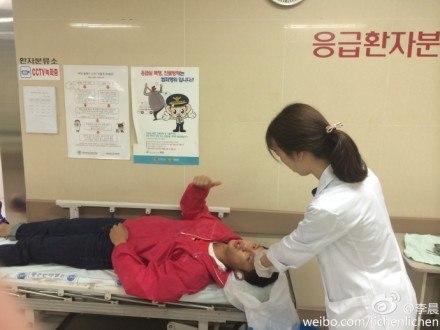 Li Chen getting stitches