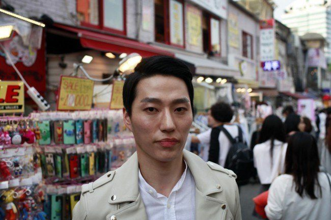 Lee Woo Jung, a gym trainer out and about in Hongdae shopping for make up products.