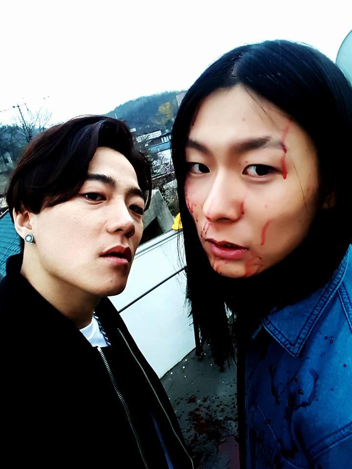 "Image: Outsider with Jang Moon Bok (""Superstar K2"") on ""Become Stronger"" MV set / Outsider's Facebook"