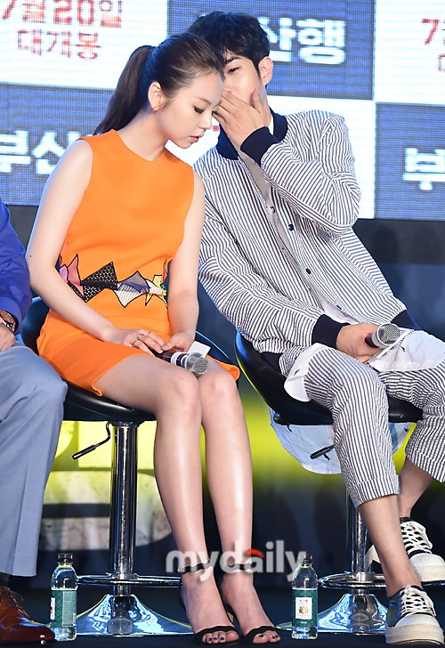 "Image: Choi Woo Sik whispering to Sohee on stage during the press conference for the film ""Train to Busan"""