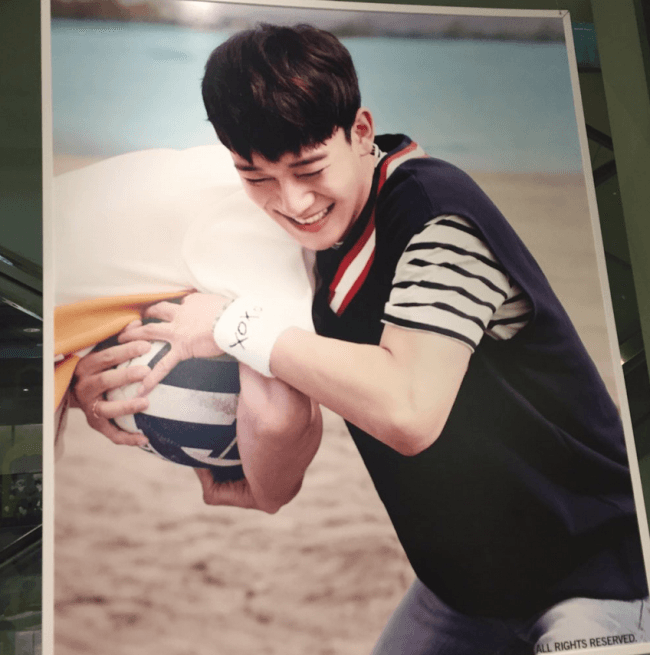Image: EXO's Chen playfully taking a volleyball from one of the members / SM Entertainment