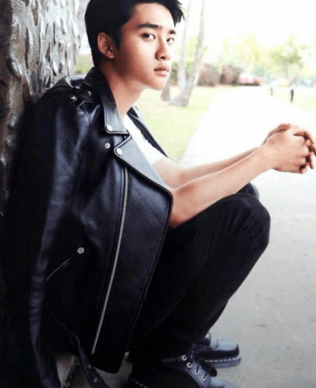 EXO's D.O. posing with a smoldering gaze at the camera in a black leather jacket / SM Entertainment