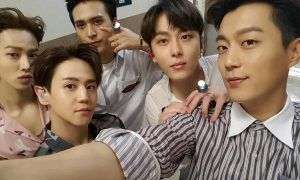 Image: BEAST as five, gearing up for a stage / Cube Entertainment