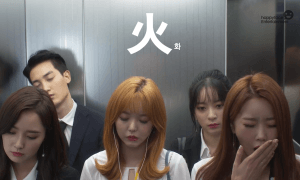 """Image: Dalshabet falling asleep in the elevator on the way to work; from their """"FRI.SAT.SUN"""" special teaser video / Happy Face Entertainment"""