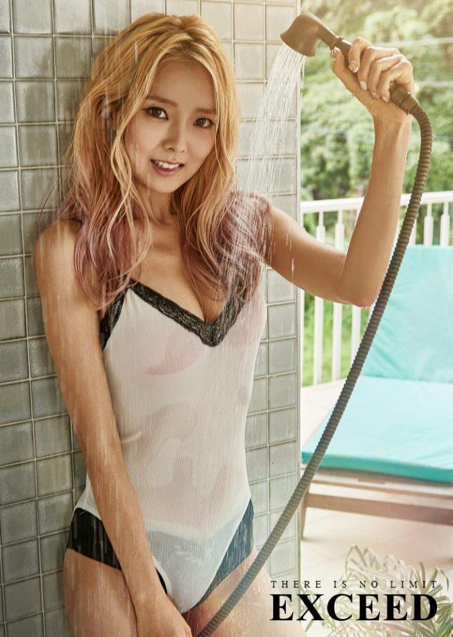 Image: STELLAR's Hyoeun drenching herself with water as she gets ready to hit the pool / EXCEED