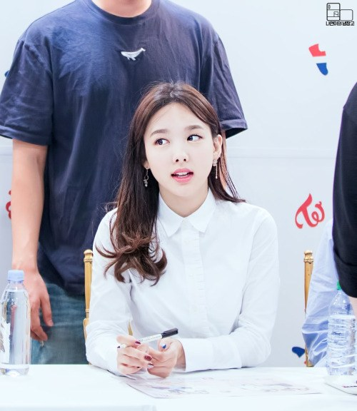 Image: Nayeon during a fan sign event / Fan take photo, credited as tagged