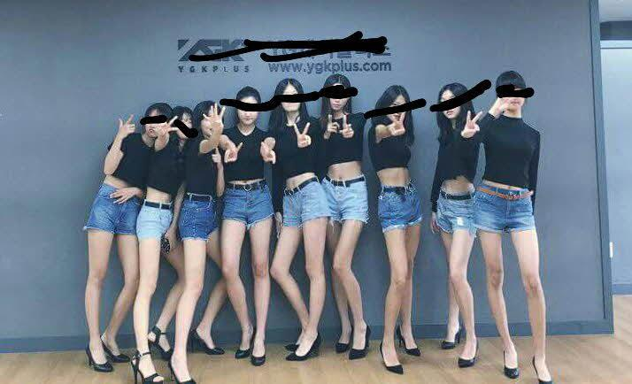 Female Models in front of the YG K Plus Sign