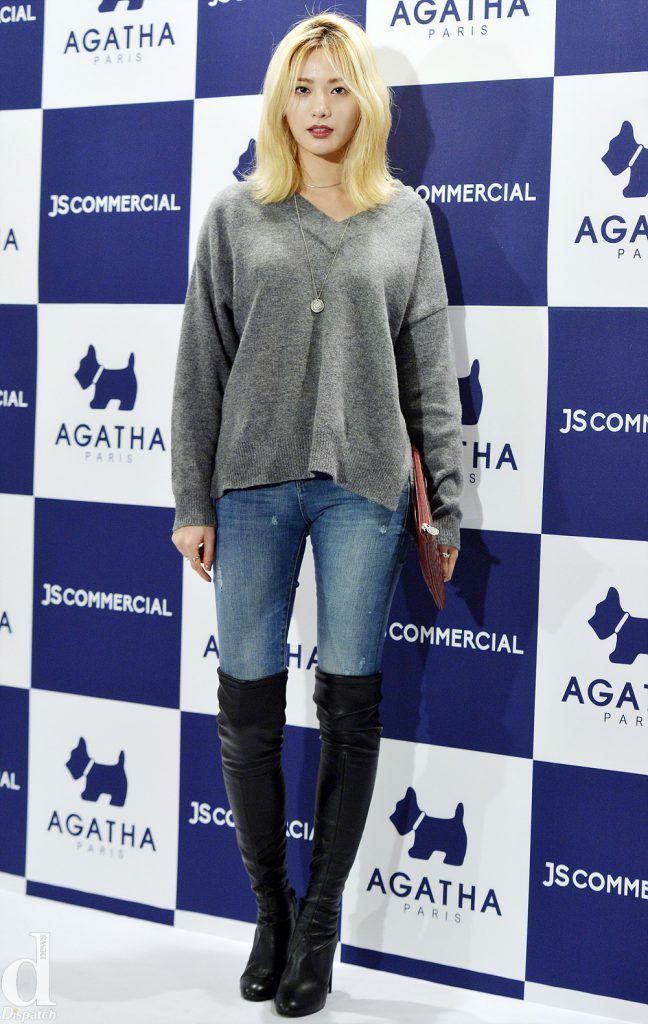 Nana looks chic and modern in distressed light blue jeans paired with a loose sweater and thigh-high boots showing off her long legs.