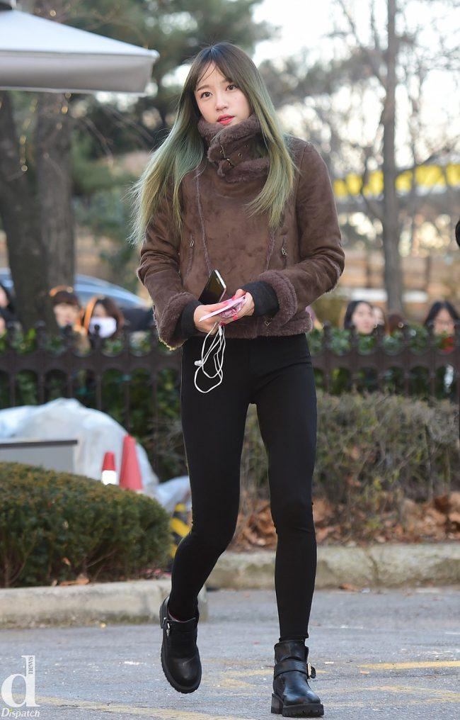 """EXID's Hani shows off her """"biker fashion"""" in black jeans, mustang jacket and thick boots. Her green hair also adds a spunky kick to her look."""