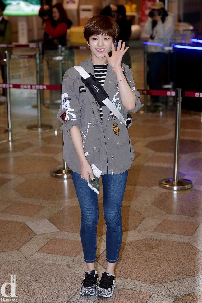 TWICE's Jungyeon goes for a more boyish, casual look with cropped blue jeans, running shoes and a studded coat.