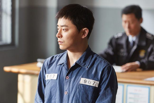 Actor Jo Jung Suk in his character's prison uniform in Hyung movie still / Image Source: CJ Entertainment