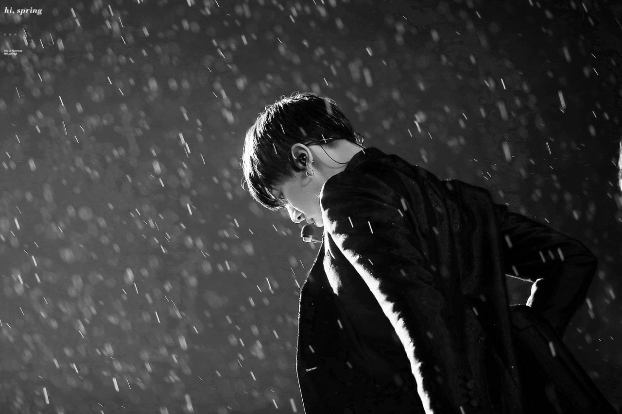 Jungkook dancing in rain, black and white photo