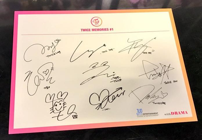 "Compare the autographs on the album above with the printed autographs from the postcard given out at TWICE's ""Memories"" showcase."