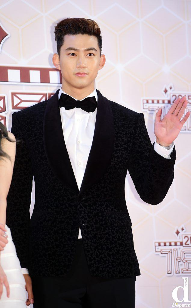 Taecyeon channels a serious and chic look with this suit.