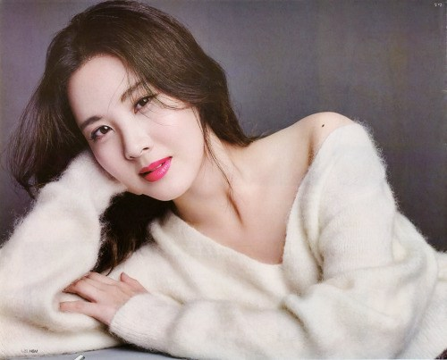 Seohyun poses for Star 1 Magazine in a low cut furry sweater.