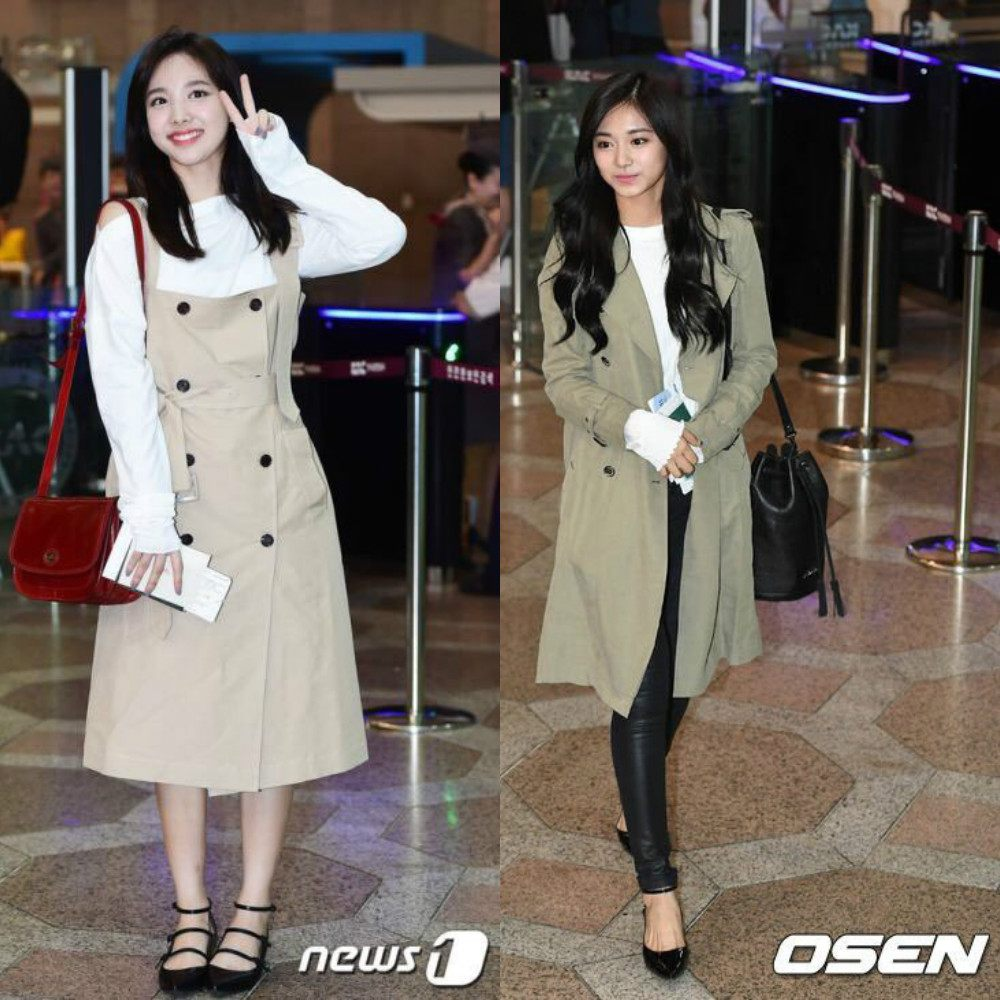 Twice's Tzuyu pulls of a graceful and innocent look with her trench coat that is matched with skinny jeans, a knitted white top, and black ballet flats.