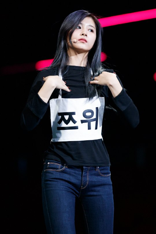 Tzuyu presents an innocent appearance as she rehearses for the stage.