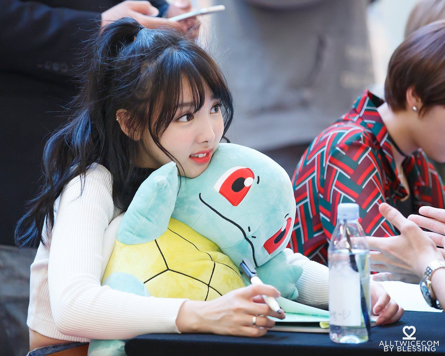 Nayeon with a pokemon toy.