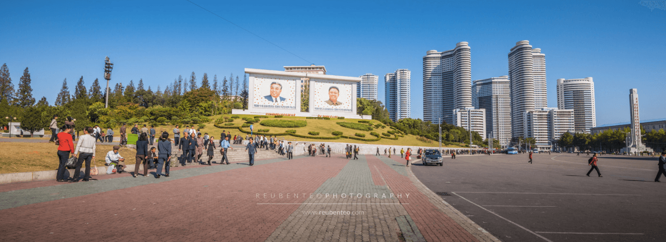 KIM PORTRAITS IN FRONT OF CHANGJON STREET APARTMENT COMPLEX