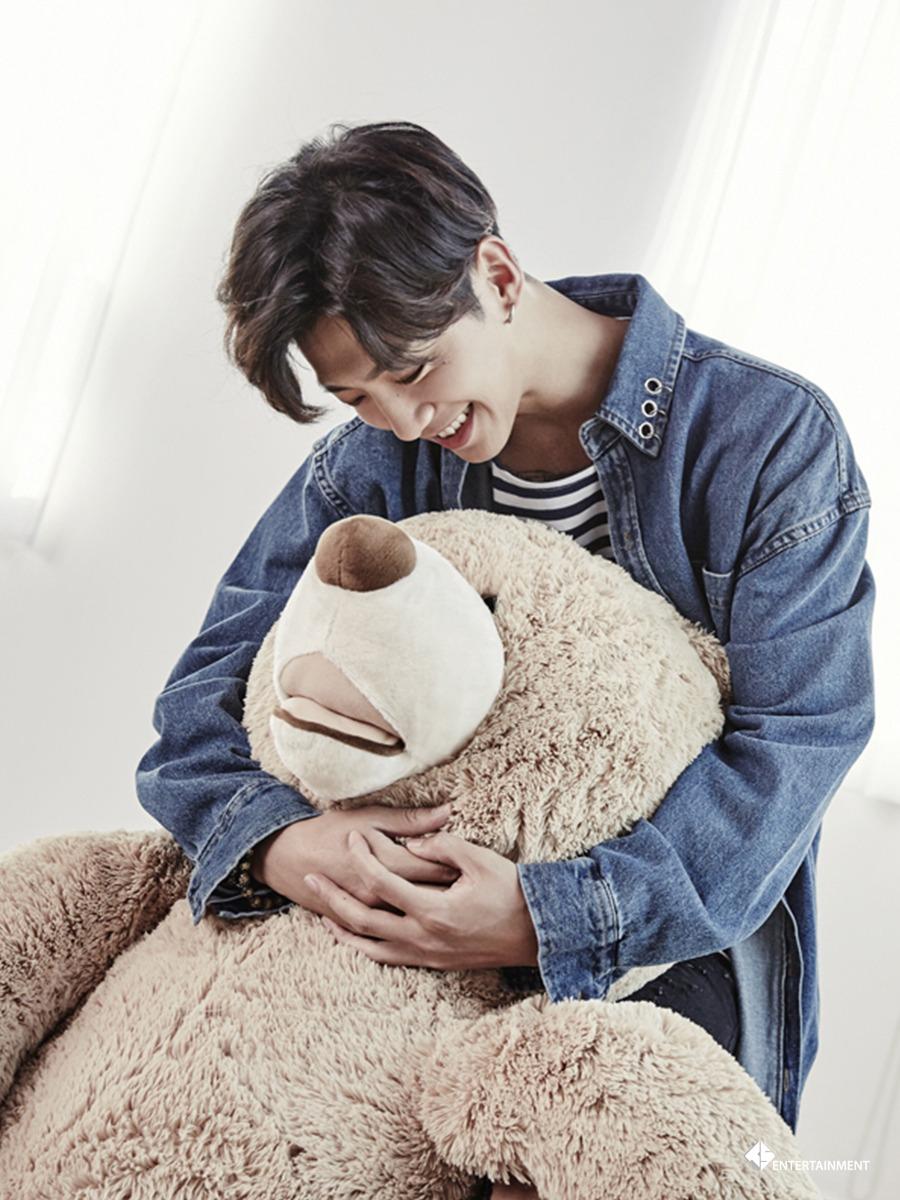 Yongguk holding a bear.