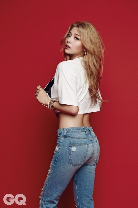 "Ailee flaunting her figure for a spread on ""GQ Korea."""