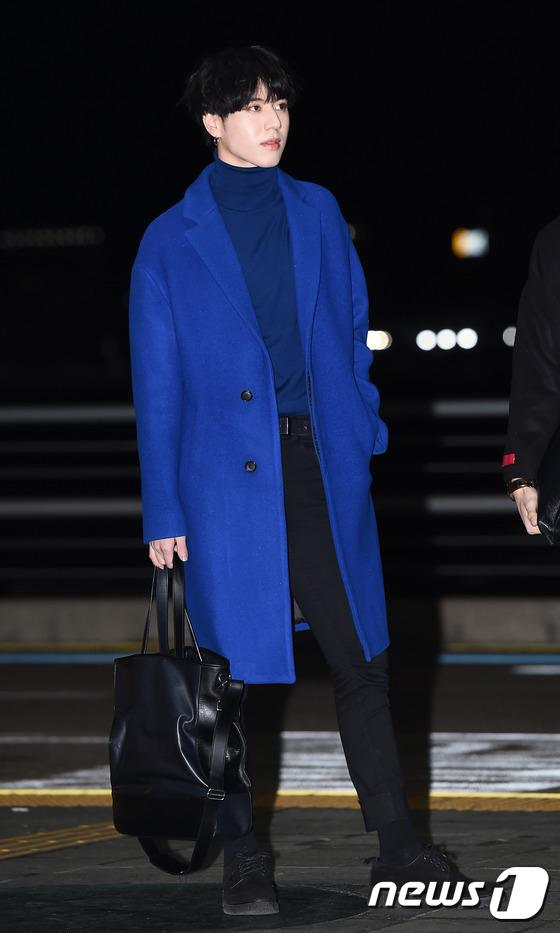 Yugyeom's airport fashion is eye-catching.