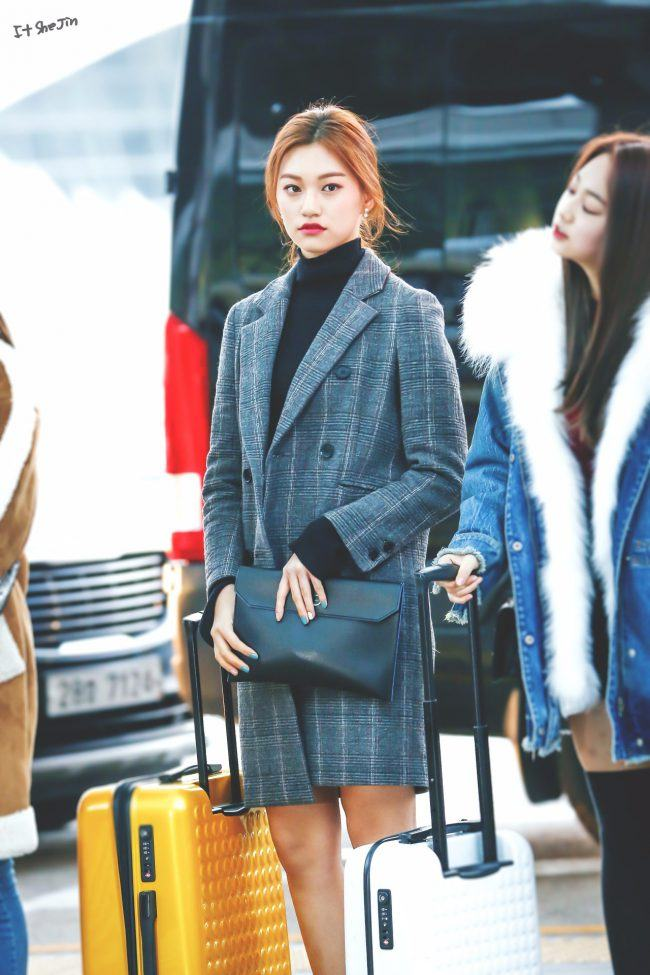 She can be a classy young lady in a trench coat.