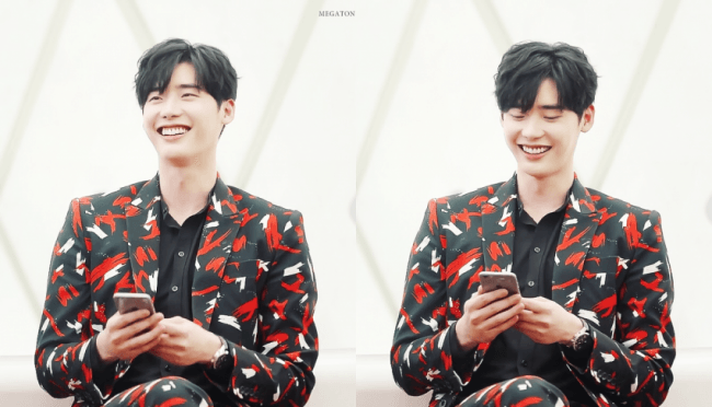His smile is just as bright as the suit he's wearing. / Source: Only Lee Jong Suk