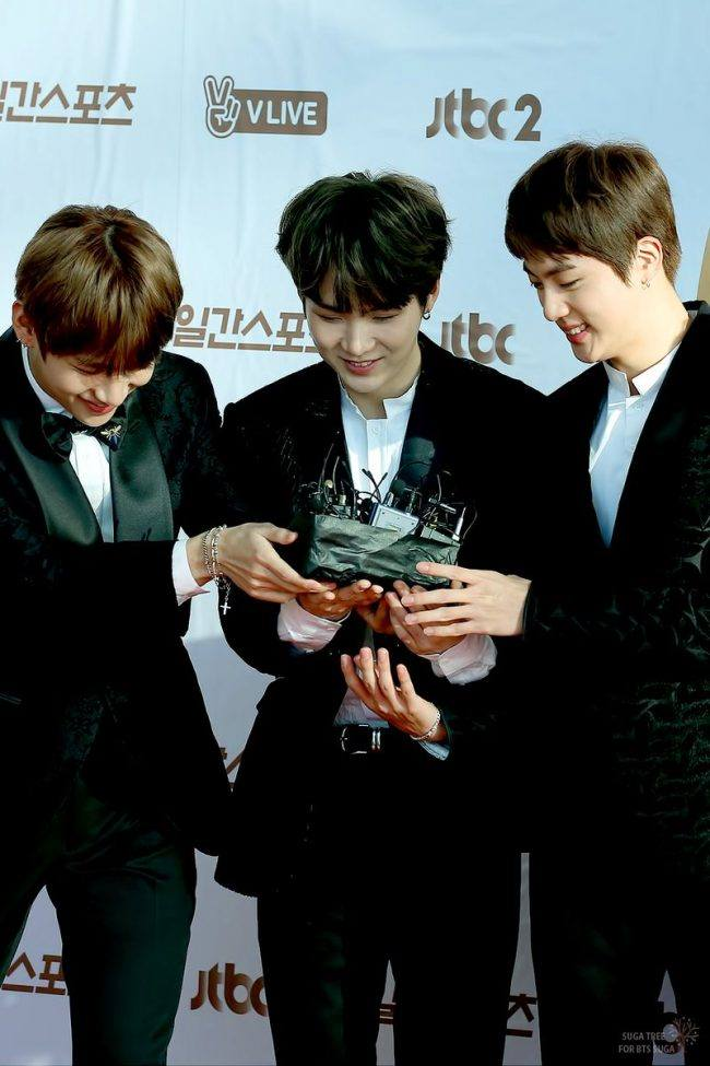 The members of BTS look so happy with their award! Congratulations!