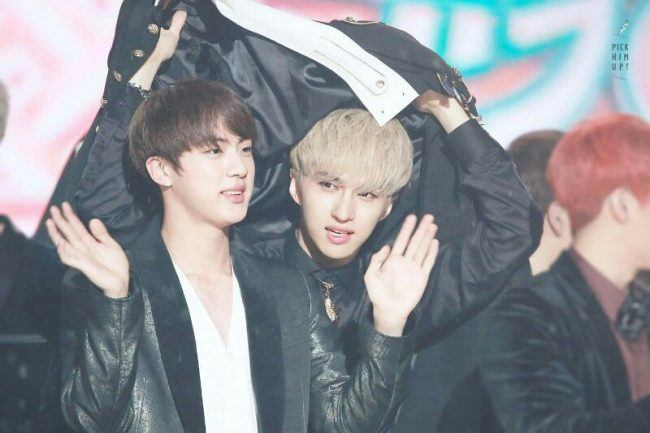 Ken and Jin under a jacket
