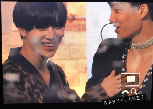 Fans caught Taemin stroking Jongin's chest during the performance.