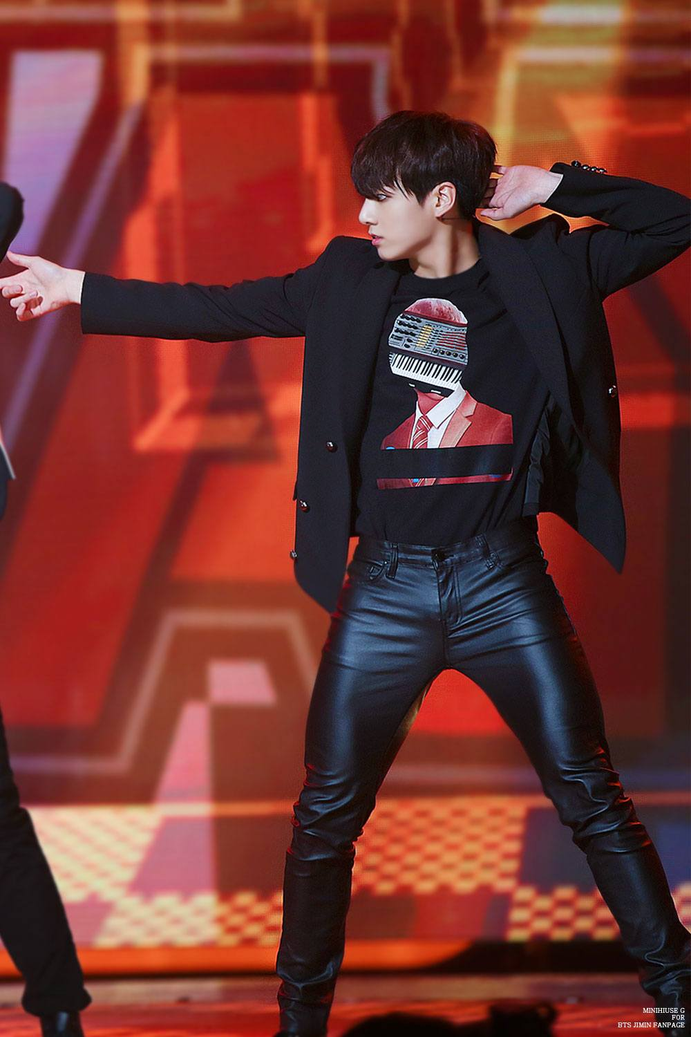 Jungkook strikes a pose in his leather pants.