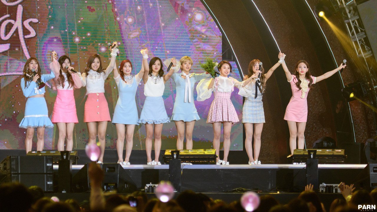 TWICE takes a bow to thank fans for their win.