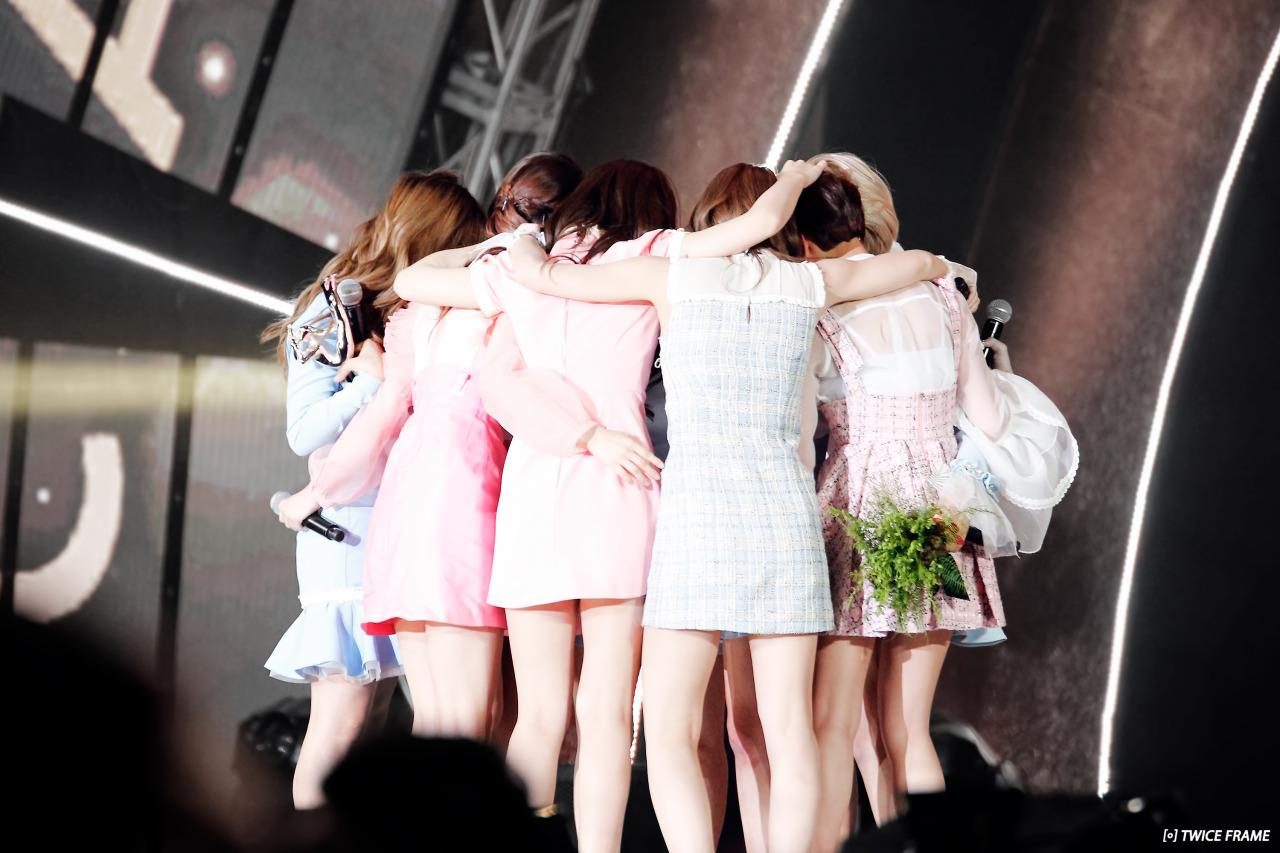 The members share a group hug to congratulate each other.