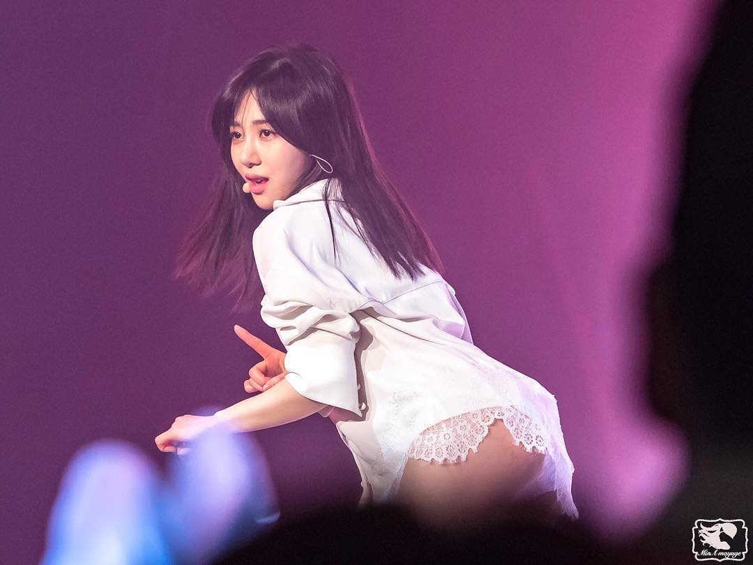 AOAs Mina wears a very loose shirt in this sexy solo performance