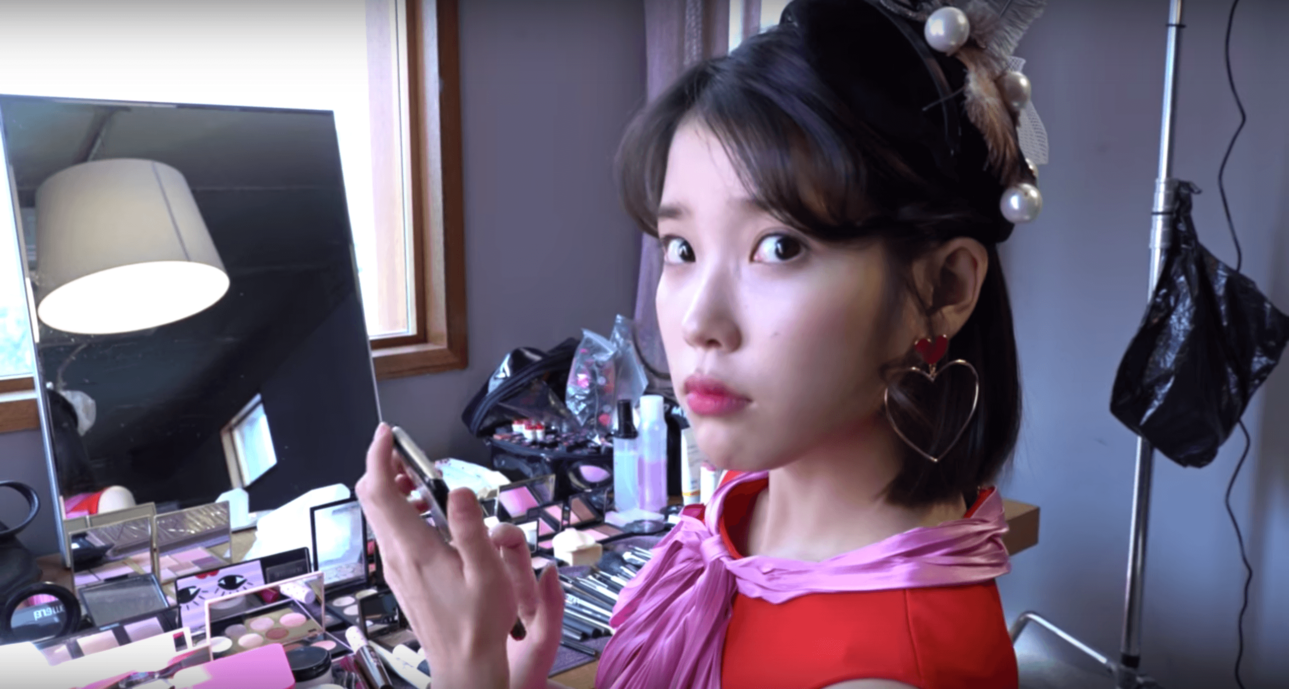 IU displays her toned body with a crop top