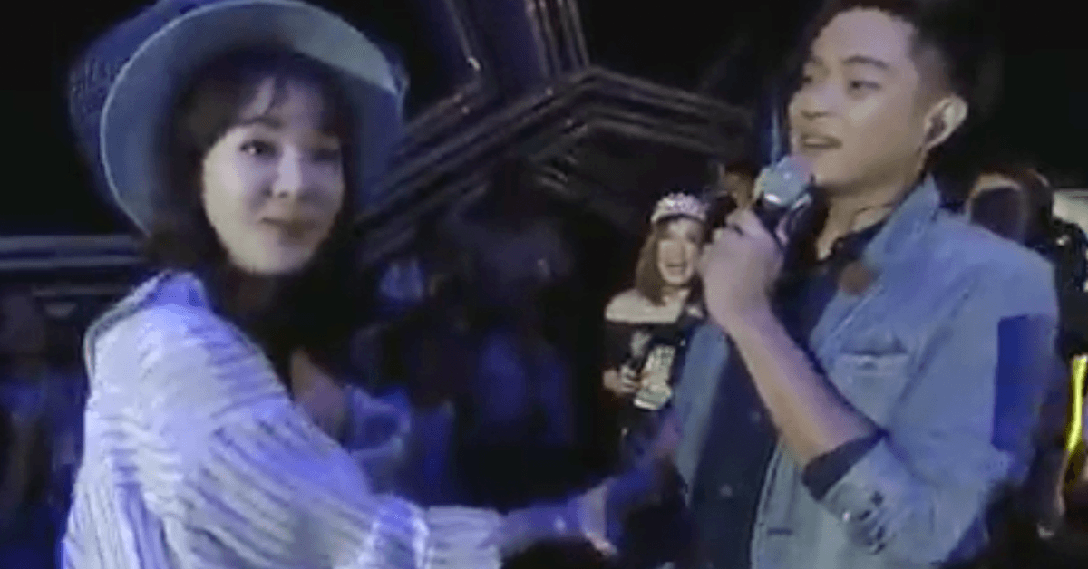 Filipino boy band member Ford hugs Dara and kisses her on the hand