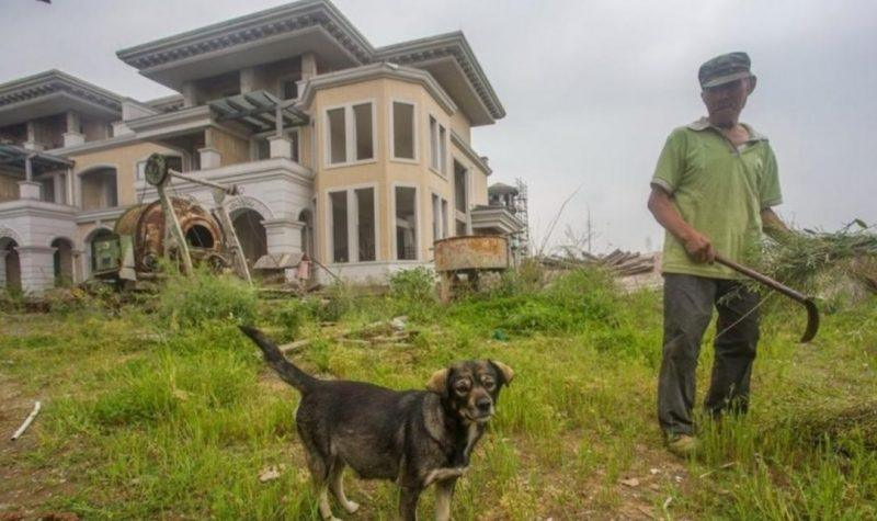 This man and his dog live in a giant abandoned luxury complex
