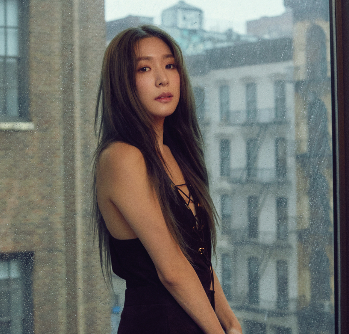 Tiffany in front of a rainy window