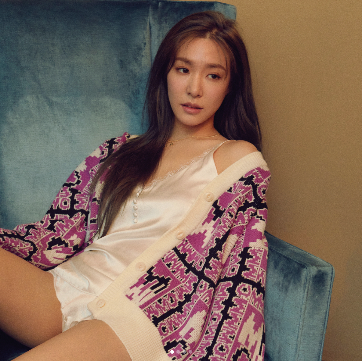 Tiffany lounging on a chair in white sleepwear